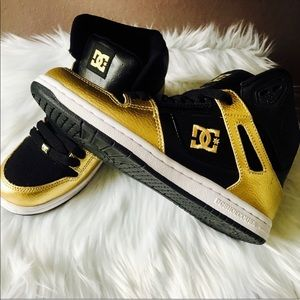 Black and gold DC shoes